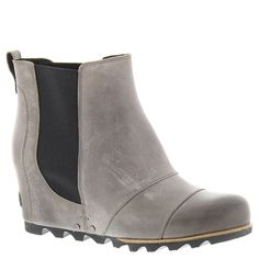 Sorel Lea Wedge Boot - Women's Dark Grey / Black 7. Upper: Waterproof full-grain leather and gore chelsea detail. Microfiber lining. Footbed: Removable molded EVA footbed with heel cup and arch support, synthetic topcover. Midsole: Molded BPU-PU wedge. Outsole: Molded rubber outsole.
