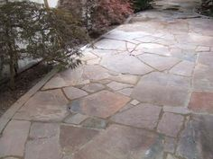 When laying flagstone walkways, always try to keep your gaps under 2 inches. (I wish more landscapers would remember this!) In this walkway, there are no excessively large gaps and stones were not cut to fit. It takes time building a puzzle like this. Picture compliments of www.american-stone.com