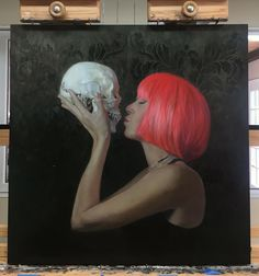 "If it's in my studio...it's never finished. Reworking the background and getting back into the arms and hands. Lol. 30""x30"" oil on dibond. #lovemyjob #neverdone #skull #pinkwig #kiss #deathandthemaiden #oilpainting #sennelierpaints #rosemarybrushes #parallelpalette #dibond #available #newmexicoartist #albuquerque #art #artist #shanalevenson"
