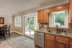 Interior image featuring a Infinity Sliding French Door and Casement windows in Stone White interior finish with White hardware and a Beige sill. Doors, Home, Kitchen Design, Sliding French Doors, Interior Renovation, Door Installation, Interior, French Doors, Build Your House