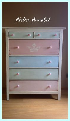 dresser with multi colored drawer fronts (pastel pink, blue, and green)