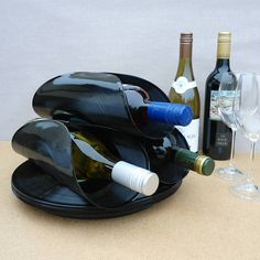 Wine racks hand made from real vinyl records and carefully sculpted to create these wine bottle holders.