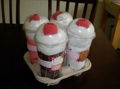 "WOW!!  Totally unique, and very reasonable to create for a baby shower gift!!  It contains 4 Onesies, 4 Diapers, 8 White Wash Cloths, 4 red ""cherry"" socks in clear cups with dome lid. INGENIOUS!!"