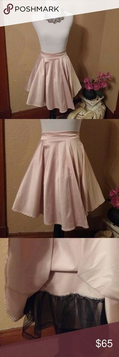 City Triangles beautiful skirt This is a gorgeous baby rose-colored beautiful skirt with tulle on your way to give it a little fullness size 11 I believe it's Juniors it doesn't say so if you need measurements please let me know. This stunning gorgeous silk like material. Tags has two piece but this is just a skirt so I must be a misprint. City Triangles Skirts