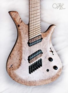 Custom Vik 7-string with fanned frets and a nice burl maple top