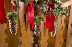 Traditional Victorian Christmas decorations made of fir cones, on the banisters at Standen, West Sussex