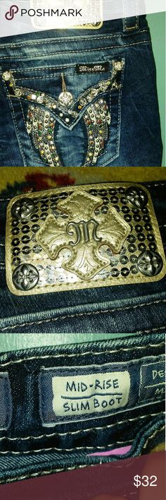 Miss Me Jeans Miss Jeans. Excellent Pre-Loved condition Angel Wing Motif Back Pockets. Bejeweled front pockets. Miss Me Jeans Boot Cut