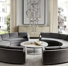 RH Modern's Curve Fabric Semicircle Sectional:The rebirth of an Atomic Age icon. Created by acclaimed midcentury designer Adrian Pearsall in the 1960s, our sectional's extravagant curves undulate across a long, low-slung silhouette, lending it a timeless look of organic luxury. Updated with fixed back cushions, the seating appears to float atop an inset maple sleigh base. Each piece can be used individually or combined to form customized configurations.