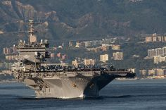 USS Enterprise transits the Strait of Messina. by Official U.S. Navy Imagery, via Flickr