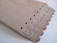 Taking brown/white paper bags and using punches to trim the tops in a pretty way, great idea found here