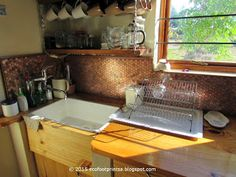 Copper coin kitchen splashback