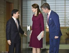Similar style: Arriving at Akasaka Palace in Tokyo, Mary stepped out in a fitted burgundy ...