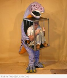 funny photos best costume ever dinosaur carrying cage