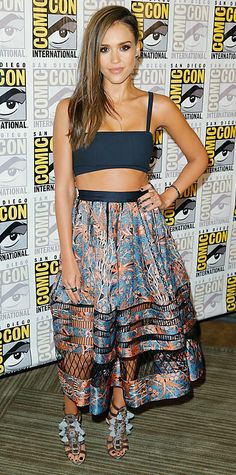 For her Sin City: A Dame to Kill For appearance at Comic-Con 2014, Jessica Alba struck a fierce pose in a black Tanya Taylor bandeau top, a printed Zimmermann midi skirt with open-work detailing, and statement tasseled Kotur heels. #InStyle