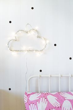 We're card carrying members of the string light appreciation society and Therese's fun and inventive DIY is a great way to add another whimsical light source to your home. Skill Level: Easy Time Required: 1 hour Project Cost: Around $10