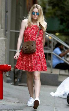 Anchors aweigh! Dakota Fanning wore a ruby red dress that was adorned with anchor patterns...