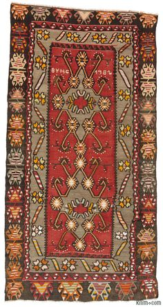 Turkish tribal kilim rug hand-woven in 1982 in Kirsehir, in Central Anatolia, Turkey. This kilim is in very good condition.