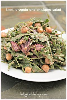 Dr. Fuhrman's Beet, Arugula and Chickpea Salad -  1/4 balsamic vinegar, water, 1/4 cup of the walnuts, raisins, mustard, garlic and thyme in a high-powered blender and process until smooth