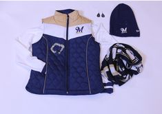 Get this look at the #Brewers Team Store:  Women's Vest- $79.00 Knit Hat- $35.00 Brewers Scarf- $30.00 Teardrop Earrings- $60.00 Heart Charm Necklace- $40.00
