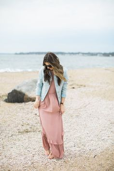 Ruffled maxi dress styled with casual studded sandals and a denim jacket