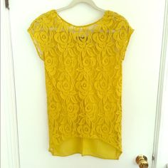 Zara Yellow Lace Top THE most gorgeous Zara top from their special garments collection. It's a yellow rosette lace with silky fabric at the back and a super flattering split hem. It has cap sleeves and is longer through the body. Worn once, this top actually got me hired at my dream fashion job when a recruiter spotted me and liked my outfit! Zara Tops Blouses
