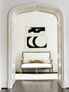 | P |  Antique settee with modern art.