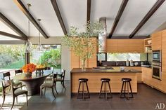 Rift-cut teak cabinetry and basalt counters and floor tiles contribute to the casual-chic vibe of the home.