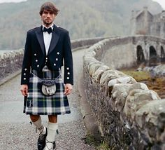Kilt guy at Eilean Donan castle - Highlands, Scotland. Seems very few can pull off a good kilt look with short hair.