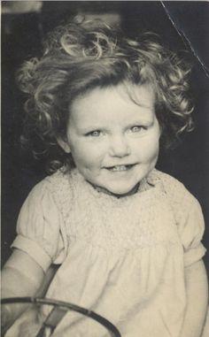 Vintage photograph of a baby girl smiling. Circa 1950's.