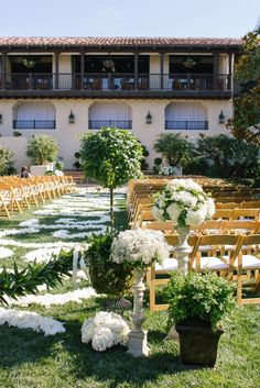 Baby's breath and greenery in vases on the white pedestals on either side of the altar opening