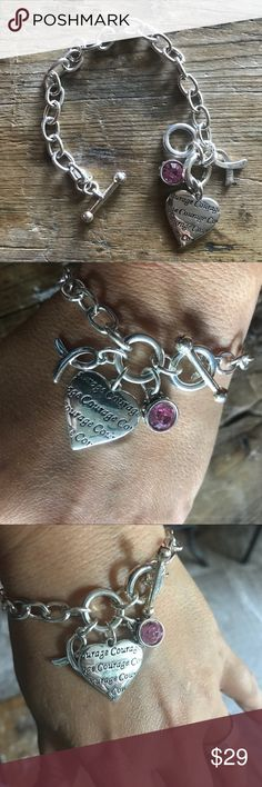NWOT Breast Cancer Courage Charm Bracelet NWOT. Received as a gift but never wore. Lovely piece but I don't wear bracelets. Jewelry Bracelets