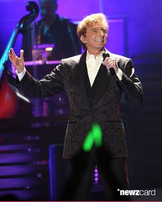Nick cannon barry manilow and megan hilty celebrate the fourth of barry manilow performs during the final date of his one last time tour on his birthday at barclays center in his hometown of brooklyn new york city bookmarktalkfo Image collections