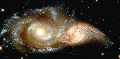 """Hubble Space Telescope: """"The glowering eyes from 114 million light years away are the swirling cores of two merging galaxies called NGC 2207 and IC 2163 in the distant Canis Major constellation. Hubble Photos, Hubble Pictures, Hubble Images, Orion Nebula, Andromeda Galaxy, Helix Nebula, Carina Nebula, Hubble Space Telescope, Space And Astronomy"""