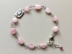 A beautiful bracelet of wire wrapped Rose Quartz. Wire wraps are oxidized. At the center is a box holding a sweet heart. Sterling Silver lobster clasp and heart link extension chain. ´Love with all your Heart´exclusive at Mel Carlo Stone Designs.