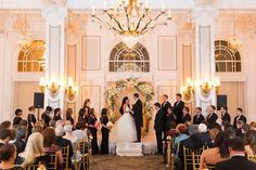 Wedding Arch decorated with cream, blush and light peach tones at The Georgian Terrace | all floral & arch rental by anik designs - Photos by Rodinis Films