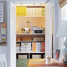 {Image: Elle Decor} ~ Who says your office storage closet has to be boring? Run an electric cord into it to hide your printer too!