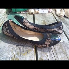 Cute flats Mostly black flats with black toes and heels. Black lace on aides with tan under tone. Only worn once Capelli new york Shoes Flats & Loafers