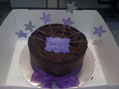 Purple on chocolate ganache classic birthday cake.