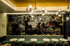 The Starbucks store on world-famous Lincoln Road captures the glitz and glamour of south Miami Beach with a gold leaf ceiling, smoked glass chandelier, a teal leather tufted banquette, and marble table tops, while sharing the Starbucks coffee journey through a black antique mirror depicting the global coffee belt.