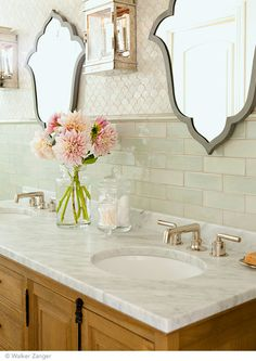 Tuileries long subway tile in Loire grace this eclectic bathroom.