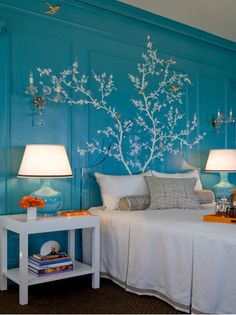 Love this blue wall, acrylic headboard, and wall painting