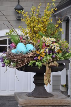 Spring or Easter Urn. Great as a centerpiece or in an entry way! (Urn with Flowers, nest, eggs, bow...)