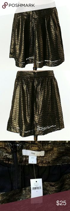 """*Sale* $60 NWT Perfect Metallic Gold Party Skirt Dressy gold A-line skirt with pockets! Perfect for parties, the office, or just looking chic. Has a gold foil appearance, so it looks diffetent depending on how it catches the light. Rough hemmed finish, see 4th pic.   Approx 17"""" long. Model is 5'11"""" & wearing heels. 100% Polyester. Orig retail = $59.95. Sz 4. Will fit a Sz 6 too.  I'm selling lots of NWT items & other Sz 4/S pieces. Pls check out my closet for more items to bundle w…"""