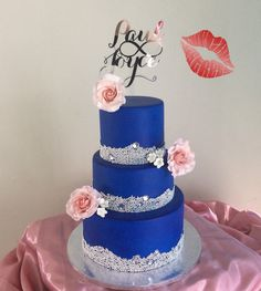 Elegant twotiered royal blue and silver wedding cake Handpiped