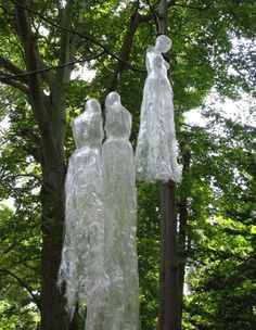 Use Saran Wrap and packing tape to create creepy figures for hanging from trees and lighting from below
