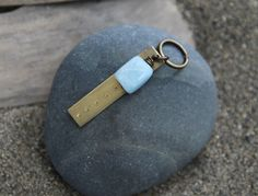 This key chain is inspired by the Five Deep Breaths practice, which invites you to pause and take five deep breaths with intention. As you breathe, relax your shoulders, notice how your breath moves in your body, try to let go of anything pulling on you, feel the space you create inside you, and let your mind rest in this space. Each hand stamped dot on this key chain is an invitation to slow down and give yourself the gift of the Five Deep Breaths practice. :: Soul Mantra key chain