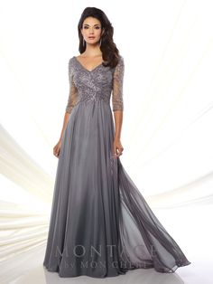 Montage by Mon Cheri - 116950 - Diamond chiffon A-line gown with hand-beaded three-quarter length sleeves, front and back V-necklines, bodice encrusted with beading, flyaway skirt with sweep train.Sizes: 4 - 20, 16W - 26WColors: Gray/Heather, Navy Blue, Rosewood