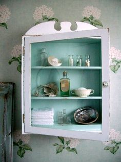 could do this with the old medicine cabinet - just take out the glass and paint the inside!