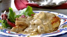 PORK CHOPS IN CREAMY BLACK PEPPER AND MUSHROOM SAUCE - Lean pork chops make a great, tasty mid-week meal and pair perfectly with a creamy black pepper sauce!