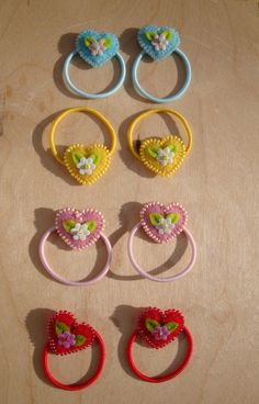 hair ties. I would probably make them into clips instead of ties.